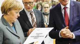 VENRO ceo bernard bornhorst with chancellor angela merkel and federal minister of economic cooperation development (bmz) gerd mueller