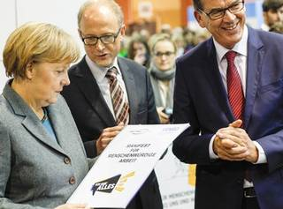 VENRO ceo bernard bornhorst with chancellor angela merkel and federal minister of economic cooperation development (bmz) gerd mueller