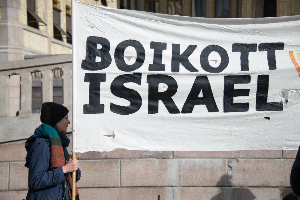boycott and lockout as an anti Boycott definition, to combine in abstaining from, or preventing dealings with, as a means of intimidation or coercion: to boycott a store see more.